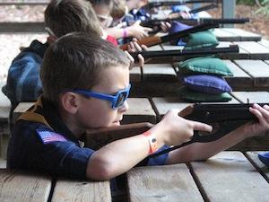 Boy Cub Scouts BB gun