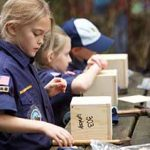 Girl Cub Scouts woodworking