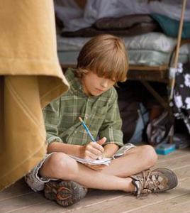 Camper writing a letter home