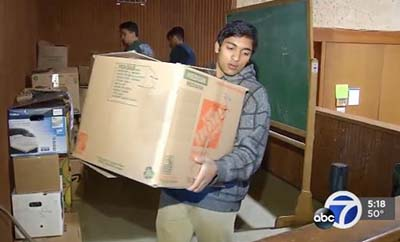 Vishank carrying a box of shoes
