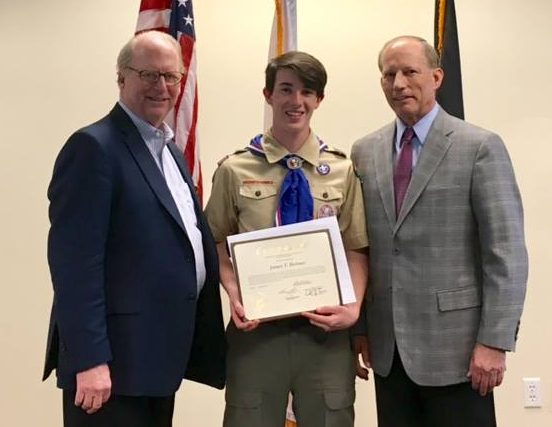 James Holmes, Eagle Scout, receiving certificate from Warren Slocum and Hank Scherf for his Eagle Scout service project