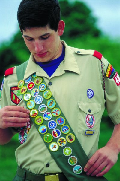 Eagle Scout wearing merit badge sash