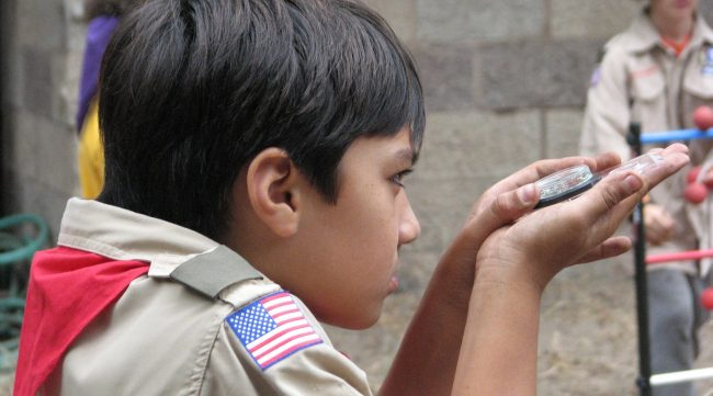 Scout learning to use a compass