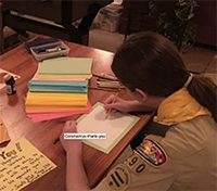 Scout writing cards