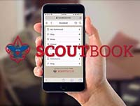 Hand holding cell phone with Scoutbook open