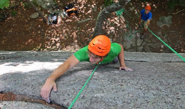 Young man rapelling, view from above