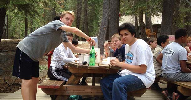 Scouts BSA boys dining outdoors at Oljato